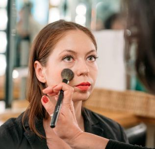 Christine Valmy makeup instructor demonstrating makeup techniques on a client